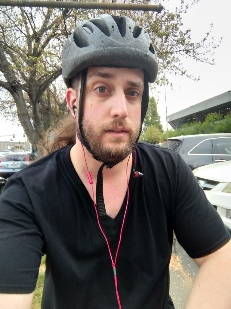 Me, looking kinda tired but otherwise good, wearing a battered bike helmet.
