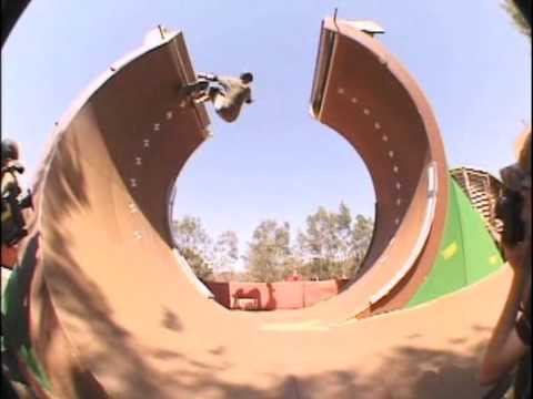 A screenshot of Tony Hawk's Pro Skater 4 with Bob Burnquist skating up a loop that has a gap at the top.